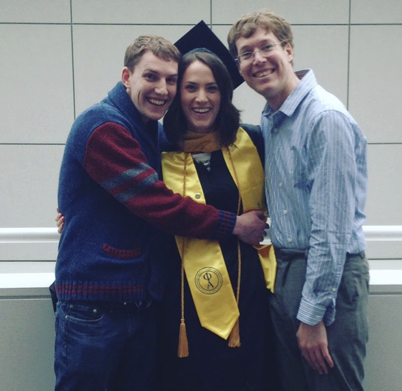 Beth Ebert with her two brothers at graduation